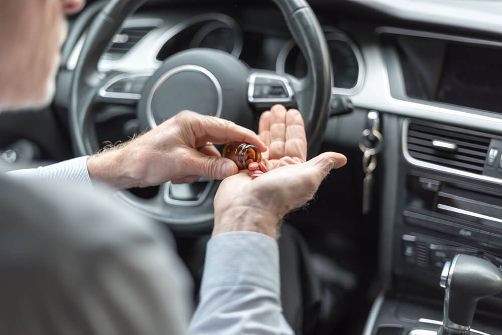 Man Taking Medication Before Driving